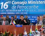 Venezuela's President Nicolas Maduro (C) speaks during the 16th PetroCaribe Ministerial Council in Caracas May 27, 2016.