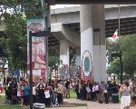 Members of San Diego's Barrio Logan community surround mural-covered pylons threatened by ultra-right groups.