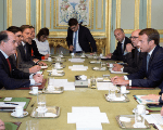 Macron talks with Borges and Guevara during a meeting at the Elysee Palace in Paris, September 4.