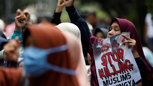 Muslim women activists take part in a rally in support of Myanmar