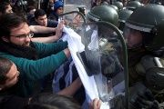 Demonstrators clash with riot policemen during a rally of students and workers of