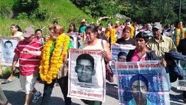 Families of the 43 students march in Mexico.