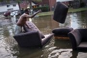 Vince Ware moves his sofas onto the sidewalk from his home which was left flooded by Harvey, Houston, Texas, U.S. Sept. 3, 2017.