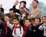 Children from the DPRK waving.