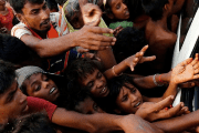 Rohingya refugees stretch their hands for food near Balukhali in Cox's Bazar, Bangladesh, September 4, 2017.