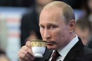 Russian President Vladimir Putin sips a hot cup of tea. (FILE)