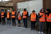 Escorts who ensure women can reach the clinic lineup as they face off protesters outside the EMW Women's Surgical Center in Louisville, Kentucky, U.S. on January 27, 2017.
