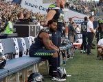 Seattle Seahawks' defensive end Michael Bennett sits out the national anthem on Aug 25, 2017.