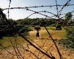 A Rohingya man carrying his belongings approaches the Bangladesh-Myanmar border in Bandarban, an area under Cox's Bazar authority, Bangladesh.