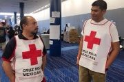 Marco Franco (L), deputy director of Mexican Red Cross disaster relief, talks with Gustavo Santillan as part of a group of Mexican Red Cross volunteers.