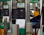 A gas station worker puts fuel in a car in Santo Domingo, Dominican Republic.