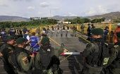 Colombian policemen stand guard in front of the border with Venezuelan policemen near Villa del Rosario village.