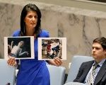 U.S. ambassador Nikki Haley speaking to the United Nations in April, holding photos and levying accusations that Syria was responsible for the chemical weapons released that killed over 80.