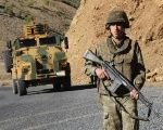 Turkish soldiers patrol a road near Uludere in the Sirnak province, southeastern Turkey.