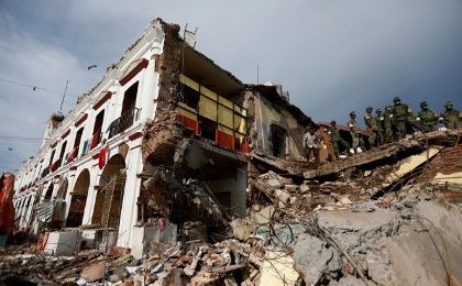 Soldiers work to remove the debris of a house destroyed in an earthquake in Juchitan, Mexico, on September 8, 2017.