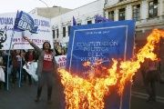 Students burn an effigy of the Chilean Constitution during a protest in Santiago against the previous abortion ban.