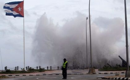 A police officer stands on the seafront boulevard El Malecon ahead of the passing of Hurricane Irma, in Havana, Cuba September 9, 2017.