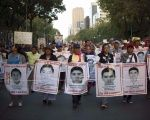 People march on November 26, 2015 to demand justice in the Ayotzinapa case.