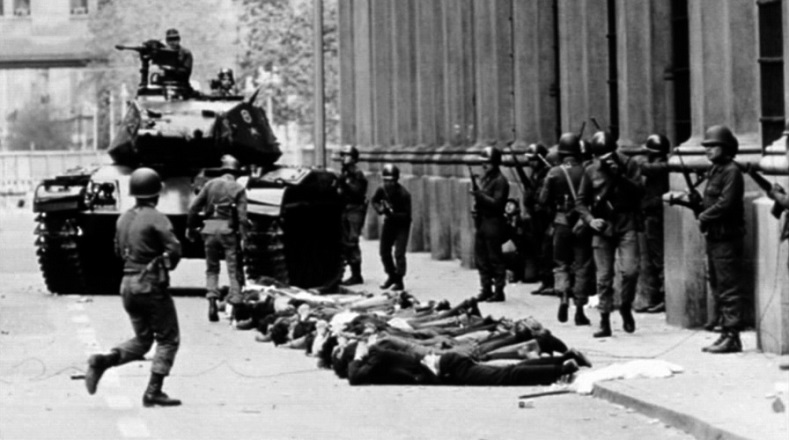 Troops under Pinochet, who had been appointed commander in chief, round up people on the streets of Santiago, Sept. 11, 1973.