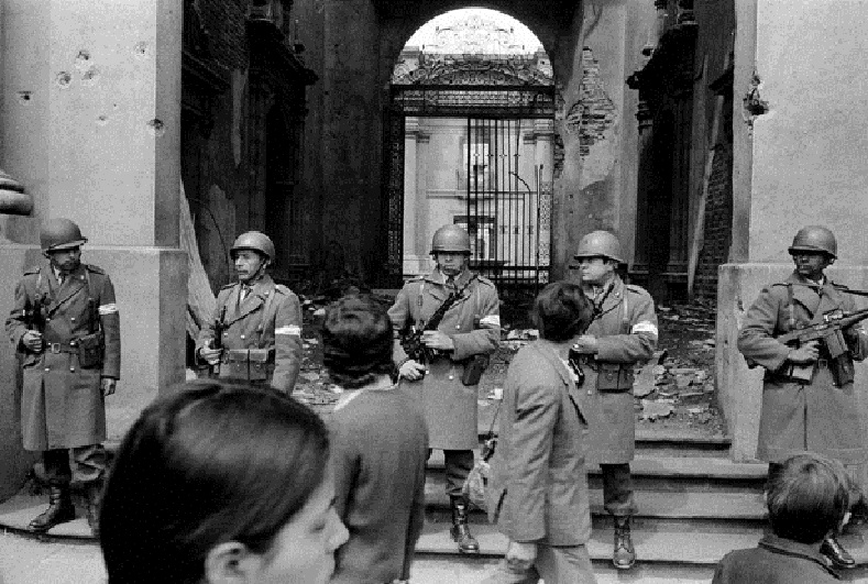 Chilean soldiers guard the presidential palace the day after the coup against Allende, Sept. 12, 1973.