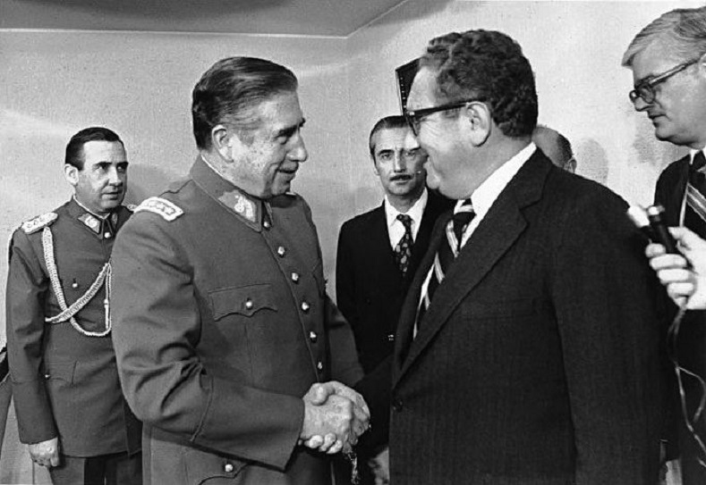 U.S. Secretary of State Henry Kissinger meets Pinochet in 1976. The U.S. role in the coup is well-documented and condemned.