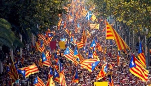"People hold Catalan separatist flags known as ""Esteladas"" during a gathering to mark the Calatan day ""Diada"" in central Barcelona, Spain."