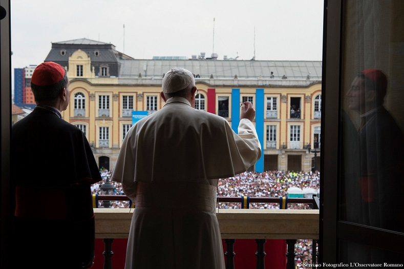 Pope Francis addresses the crowd before giving a blessing from the balcony of the Cardinal