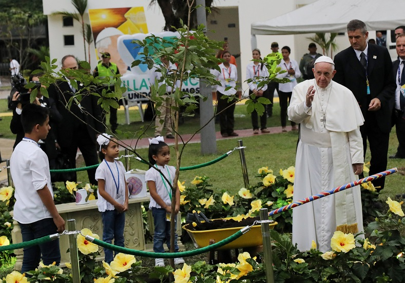 Pope Francis plants a tree during a visit to the cross of the reconciliation at Fundadores park in Villavicencio, Colombia, Sept. 8, 2017.