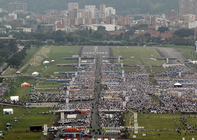 People gather as they wait for Francis to lead mass at the Enrique Olaya Herrera airport in Medellin,Colombia, Sept. 9, 2017.