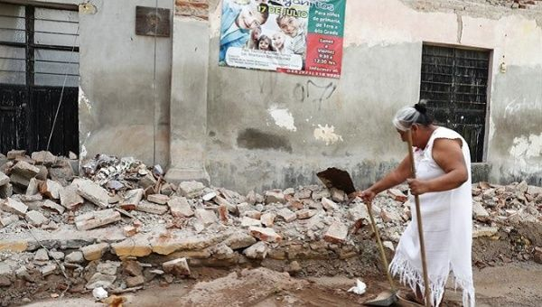 A resident of Juchitán walks through the rubble left by the 8.1-magnitude earthquake.