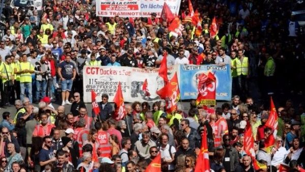 Demonstrators, holding CGT labour union flags, attend a national strike and protest against the government