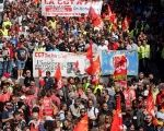 Demonstrators, holding CGT labour union flags, attend a national strike and protest against the government's labor reforms in Marseille, France.