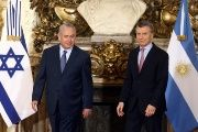 Israeli Prime Minister Netanyahu and Argentina's President Macri arrive for a ceremony at the Casa Rosada Presidential Palace in Buenos Aires