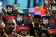 People holds up portraits of Santiago Maldonado, a protester who has been missing since security forces clashed with indigenous activists in Patagonia.