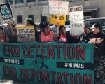 Members of the Detention Watch Network, Mijente, and NWDC Resistance hold an action at ICE Enforcement and Removal Operations field office in Seattle, Washington, Sept. 12, 2017.