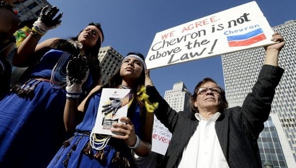 Indigenous activists demand that Chevron pay Ecuador for the environmental damage it has caused throughout the years.