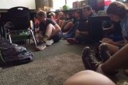 Students sit on the floor during an active shooting at Freeman High School in the U.S. state of Washington.
