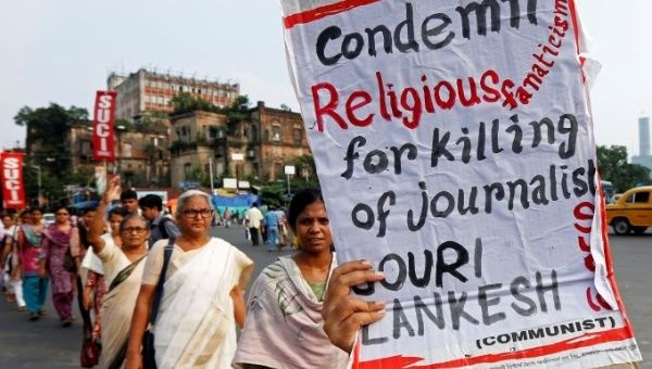 Journalists and civil society members across the country protested Lankesh