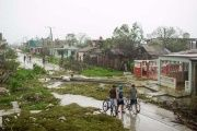 People walk on a damaged street after the passage of Hurricane Irma in Caibarien, Cuba.