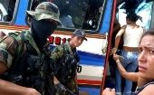 Members of the right-wing paramilitary group the United Self-Defense Forces of Colombia inspect a bus.
