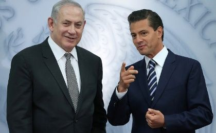 Netanyahu speaks with Pena Nieto during an address to the media at Los Pinos presidential residence in Mexico City, Mexico.