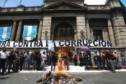Demonstrators protest outside the Congress against a new law that shields senior party leaders from prosecution for campaign-financing violations, in Guatemala City, Guatemala on Sept. 14, 2017.