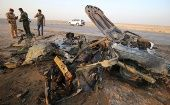 The remains of the vehicle used in a car bomb attack in a terrorist attack that claimed over 80 lives in Iraq.