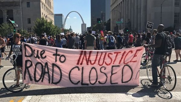 People march downtown after the not guilty verdict in the murder trial of Jason Stockley.