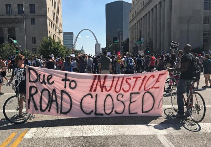 Protesters also demanded that police resign, while also calling for an economic boycott of St. Louis.
