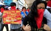 Protesters call for the resumption of peace talks between the government and the NDF during a protest along a main road in Manila, Philippines.