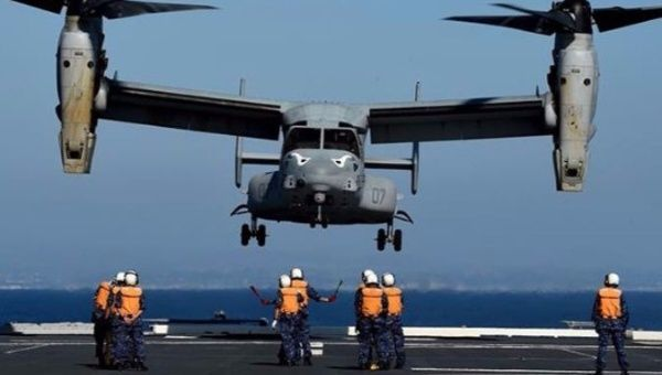 Japanese forces directing a U.S. Marines MV-22 Osprey to land during a joint military exercise in 2015.