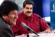 President Nicolas Maduro listens to Bolivian President Evo Morales speak during the solidarity summit.