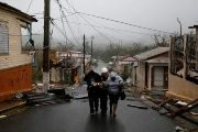 Rescue workers help people after the area was hit by Hurricane Maria in Guayama, Puerto Rico.