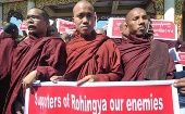 Buddhist monks in Yangon hold an anti-Rohingya banner on Jan. 16, 2014
